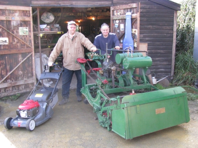 Andrew Hall and Michael Duck with the 1902 Ransomes motor mower and the prize Honda rotary.
